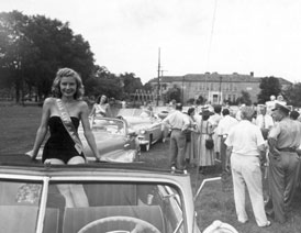 Photo---Live-Oak---Tobacco-Festival-with-Metcalfe-School-in-Background---1949
