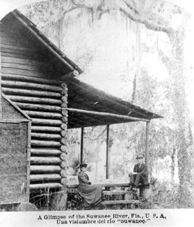 Photo---Suwannee-County---Couple-Sitting-by-their-Cabin-on-the-River---1895---February-4
